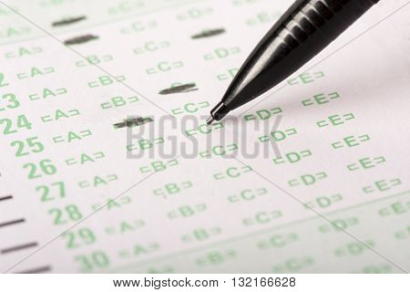 An answer sheet or optical mark recognition sheet with a mechanical pencil about to fill in an answer.