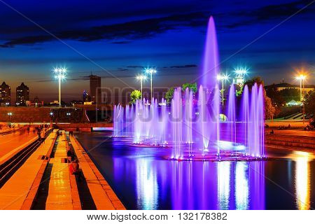 illuminated in different colors at night fountains. Summer Yekaterinburg.