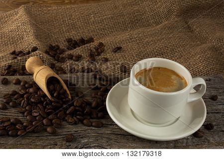 Coffee cup and coffee beans. Cup of coffee. Strong coffee. Morning coffee. Coffee break. Coffee mug. Coffee cup.