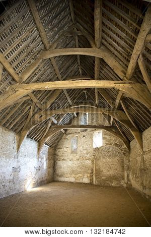 Old tithe barn in the village of Lacock in Wiltshire UK
