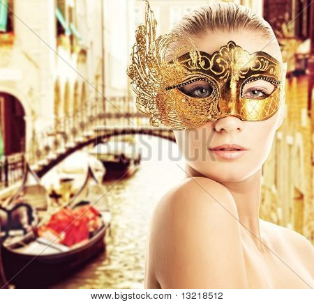 Woman with carnival mask in Venice