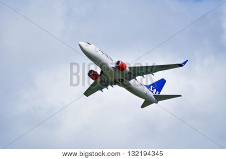 ST PETERSBURG RUSSIA - MAY 11 2016. LN-RNU SAS Scandinavian Airlines System Boeing 737 Next Gen airplane is flying in the sky after departure from Pulkovo International airport