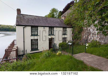 Dylan Thomas Boathouse Laugharne, Carmarthenshire - May 24, 2016: The Boathouse at Laugharne where the Welsh poet, writer and broadcaster Dylan Thomas lived 1949-1953 with his family.