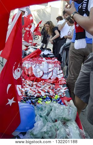 Istanbul Turkey - June 9 2013: Products sold in the protest area Helmet Whistle badges flags hats gas masks. A wave of demonstrations and civil unrest in Turkey began on 28 May 2013 initially to contest the urban development plan for Istanbul's Taksim Gez
