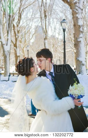 Bride And Groom In Winter Park