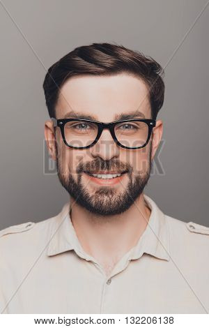 Portrait Of Happy Smiling Brainy Young Guy In Spectacles