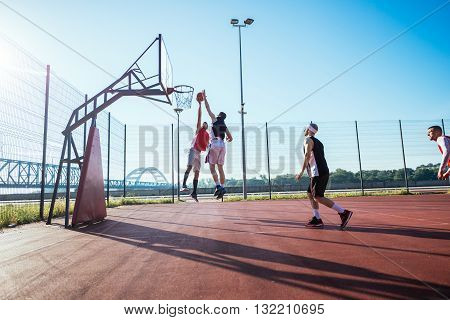 Two basketball players jumping for the ball