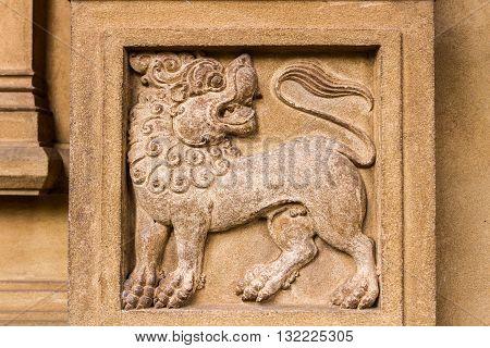 A carving of a lion at the Buddhist temple of Kelaniya, Sri Lanka.