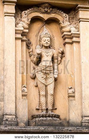 A carving of the Hindu God Vishnu at the Buddist temple of Kelaniya, Sri Lanka.