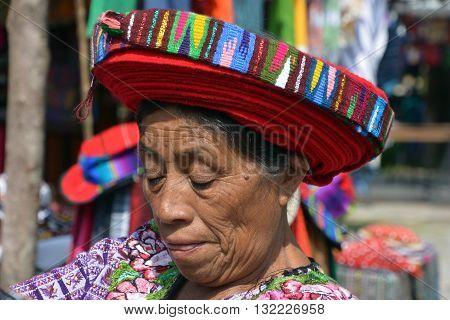 SANTIAGO DE ATITLAN GUATEMALA APRIL 29 2016: Tzutujil woman show to wearing a traditional toyocal hat. The Mayan people still make up a majority of the population in Guatemala,