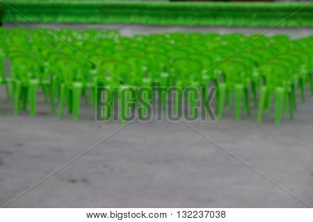 Blur of rows of multilevel empty green plastic seats