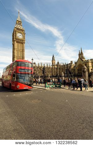 Modern Red Bus And Big Ben London