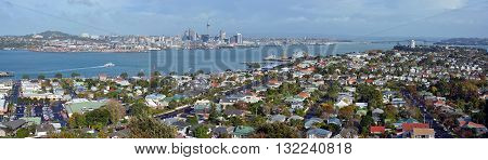 Auckland New Zealand - May 21 2016: Panoramic view from Mount Victoria Devonport towards Auckland City & The Harbour Bridge in the background with copy space.