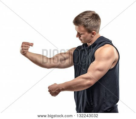 Half-length of young muscular man posing and shows arm muscles, biceps.. Biceps show, posing. Self improvement. Body power. Healthy lifestyle. Fitness and sport. Power of body. Bodybuilder posing
