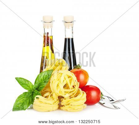 Italian colors food. Basil, pasta, tomatoes, olive oil and vinegar. Isolated on white background