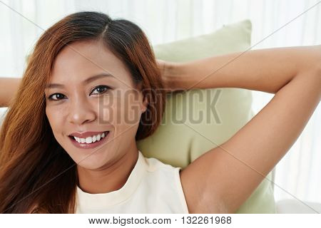 Face of smiling Filipino woman looking at camera