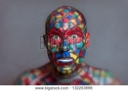 Shocked Superhero portrait colorful face art with tilt shift and motion blur effect.