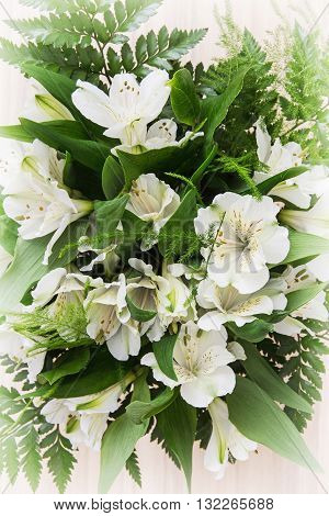 Festive bouquet of beautiful white hibiscus flowers. Big petals and pistil. Beauty in nature. Wedding bouquet. Natural decoration.