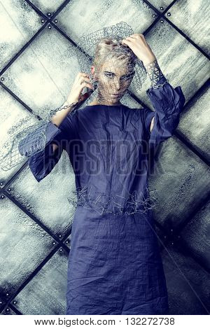 Avant-garde. Fashionable designer collection with the use of metal wire over grunge background. Urban style. Futurism.