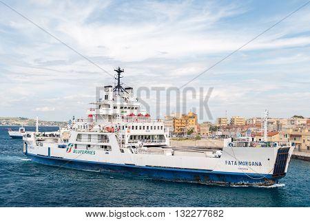 VILLA SAN GIOVANNI, ITALY - SEPTEMBER 30 2015: Ferry boat at the harbor of Villa San Giovanni in the strait of Messina