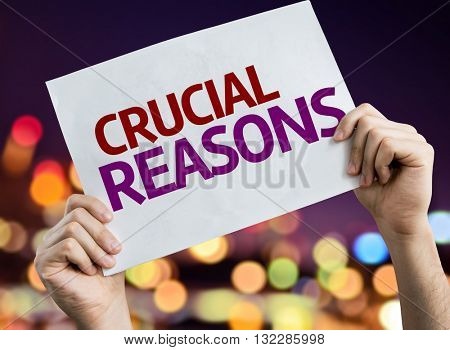 Crucial Reasons placard with night lights on background