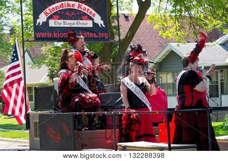 WEST ST. PAUL, MINNESOTA - MAY 21, 2016: Klondike Kates of Winter Carnival Royal Order sing and entertain crowd during annual West St. Paul Days Grande Parade in West St. Paul on May 21, 2016.