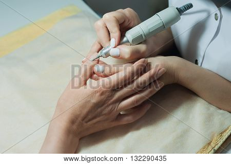 Profesional Nail Technician Sanding Nails With Machine