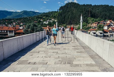 Konjic Bosnia and Herzegovina - August 25 2015. People walks on 17th century Ottoman-inspired bridge in Konjic