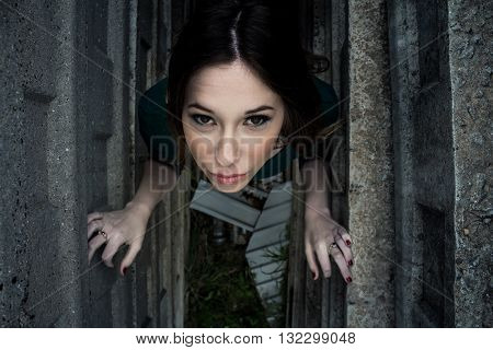 Beautiful Brunette Woman Posing Outdoor In Abandoned Industrial Place
