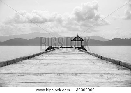 Beautiful Black and white monochrome jetty with seascape in the nature.