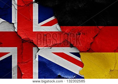 Flags Of Uk And Germany Painted On Cracked Wall