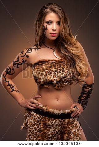 woman with sharp knife. amazon girl. tatooed face and hand