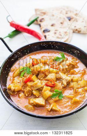 Indian tikka masala chicken and naan flat bread