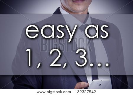 Easy As 1, 2, 3… - Young Businessman With Text - Business Concept