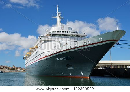 LUDERITZ NAMIBIA - JAN 27 2016: Big cruise ship Fred Olson cruise lines Boudicca shown in the port of Luderitz. Luderitz is popular destination for a many of cruise lines