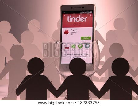 Group of people man surrounding  at social network tinder sign in page on Kuala Lumpur Malaysia, 28th may 2016,