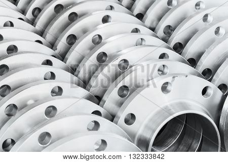 Flanges stored in the warehouse shelves, technical background