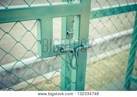 Green Metal Fence Lock With Pastel Tone