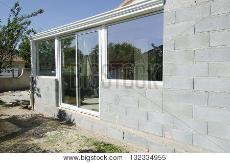 a construction veranda with windows and concrete