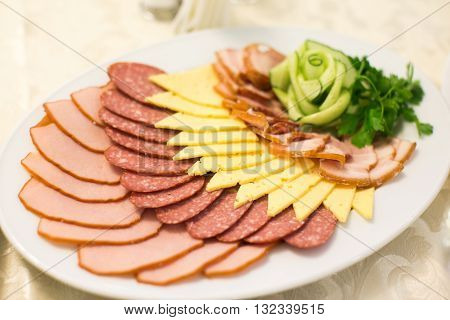 Appetizer. Plate Of Smoked Meat Or Ham With Cheese