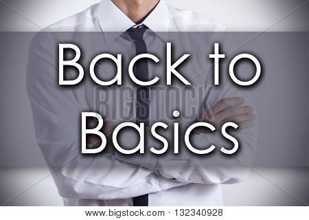 Back To Basics - Young Businessman With Text - Business Concept