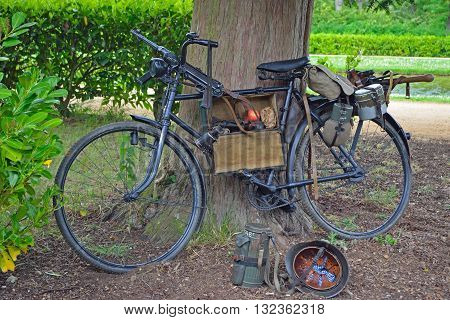 Vintage bicycle with World War 2 German Equipment Including Machine gun and Helmet.