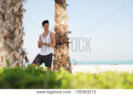 Hansome man enjoying summer on the vacation.