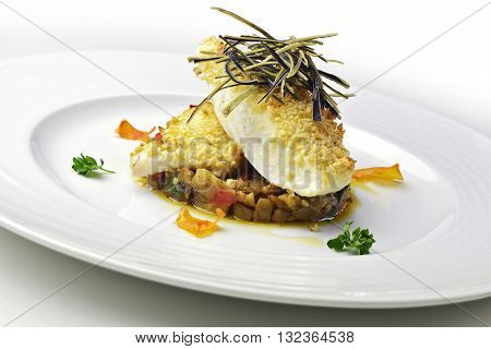 Fish dish, fillet of turbot in an almond crust on chopped eggplant and stewed with eggplant chips