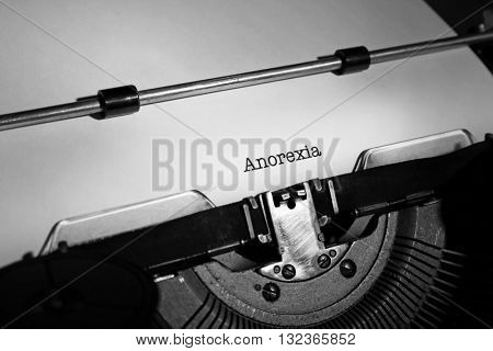 Old typewriter and inserted sheet of paper with medical report on anorexia