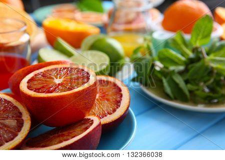 Juicy Sicilian oranges on blue wooden table