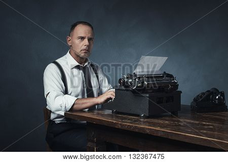 Retro 1940 Office Worker Behind Desk With Typewriter And Telephone.