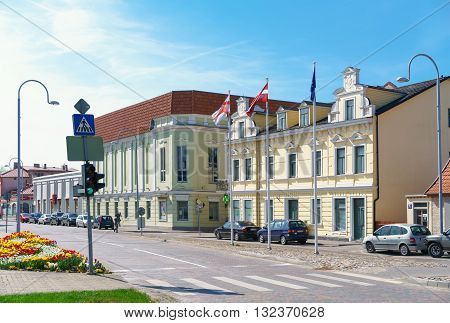 Old Yellow Building With Flags In Ventspils
