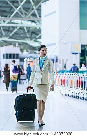 Asian Flight Attendant At Incheon International Airport
