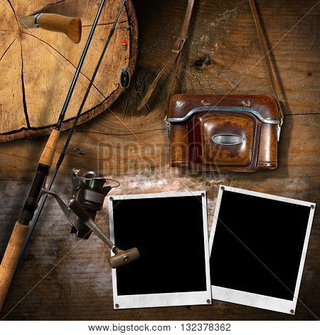 Fishing tackle vintage camera with leather case two empty instant photo frames and a penknife on a wooden wall